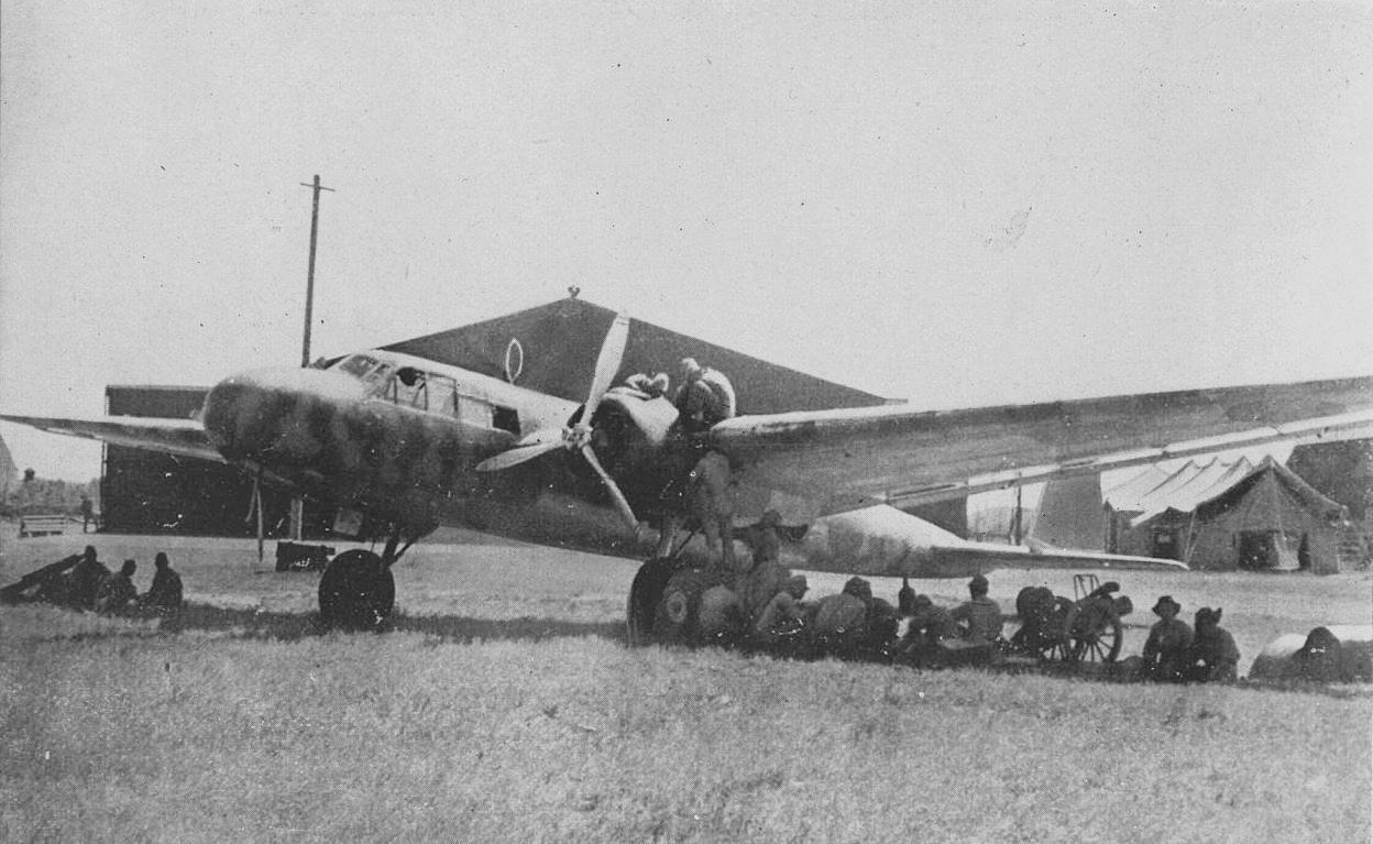 G3M crew members beneath their aircraft